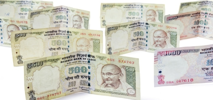 How can NRIs convert 500 and 1000 notes in UK